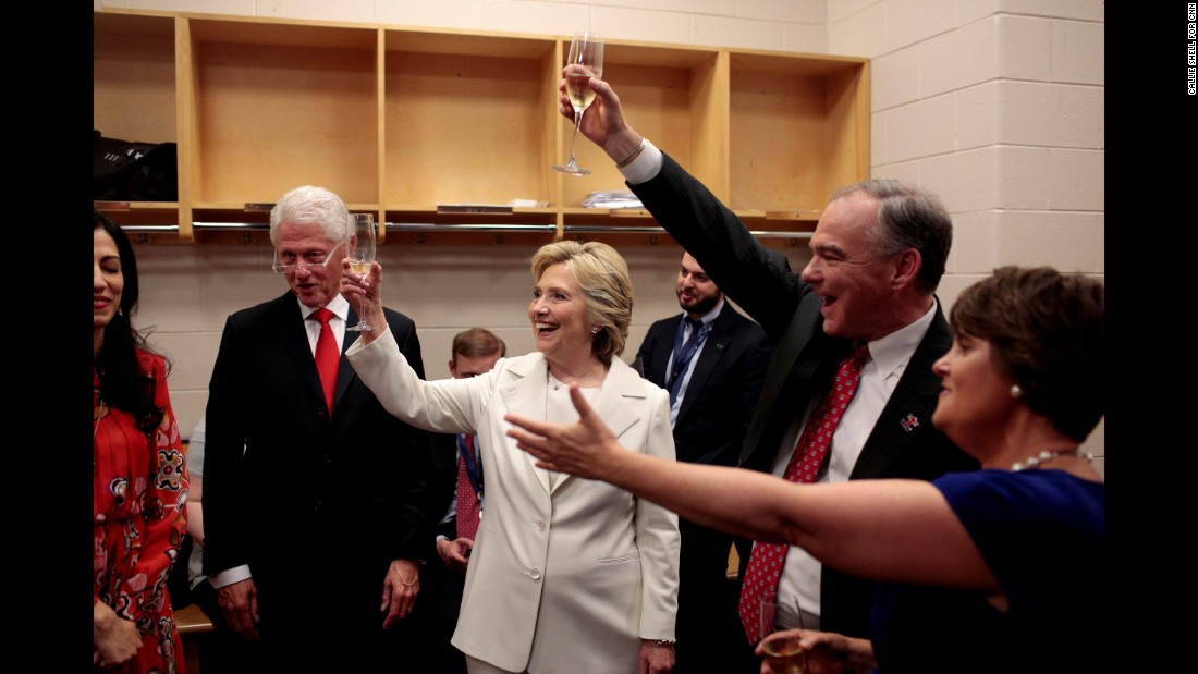 "<strong>July 27:</strong> Hillary Clinton, the Democratic Party's presidential nominee, holds up a glass as <a href=""http://www.cnn.com/2016/07/29/politics/cnnphotos-behind-the-scenes-hillary-clinton-dnc/index.html"" target=""_blank"">she celebrates backstage</a> at the Democratic National Convention. Among those joining her were her husband, former US President Bill Clinton, and her running mate, US Sen Tim Kaine."