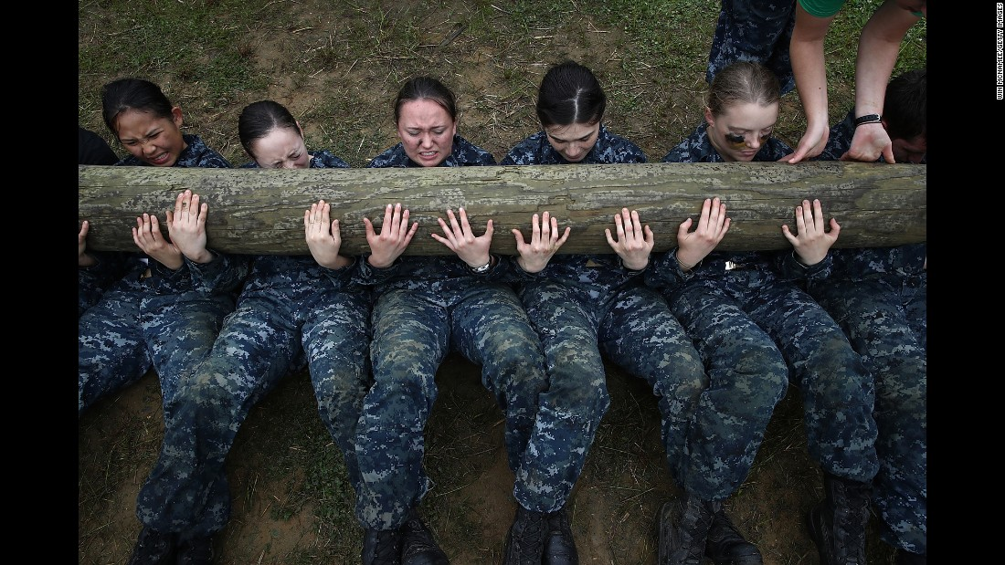 <strong>May 17:</strong> Plebes from the US Naval Academy perform situps with a 12-foot log on top of them during the annual Sea Trials training exercise.