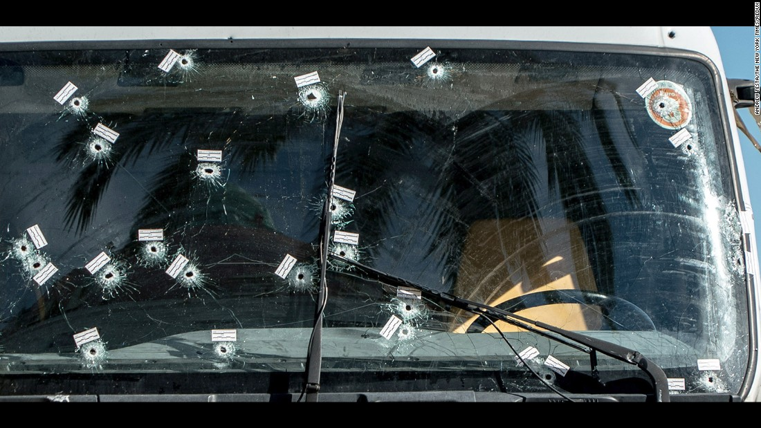 "<strong>July 15:</strong> Evidence stickers and bullet holes are seen on the windshield of the truck used in a terrorist attack in Nice, France. A man <a href=""http://www.cnn.com/2016/07/21/europe/nice-france-attacker-plot-accomplices/"" target=""_blank"">deliberately drove a truck into a crowd,</a> killing 84 people on Bastille Day. Authorities said the man plotted his attack for months with ""support and accomplices."" <a href=""http://www.cnn.com/2016/07/17/world/cnnphotos-nice-france-day-after-attack/index.html"" target=""_blank"">Life after the truck attack</a>"