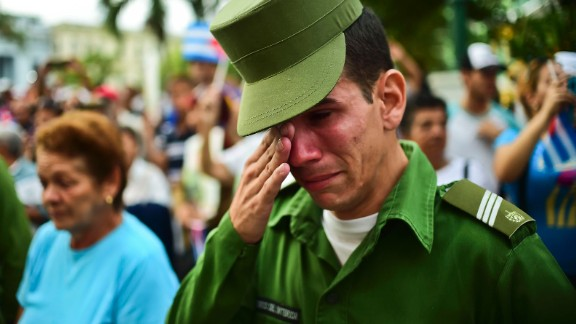 A soldier reacts after the ashes of longtime Cuban leader Fidel Castro passed through Santa Clara, Cuba, on Thursday, December 1.