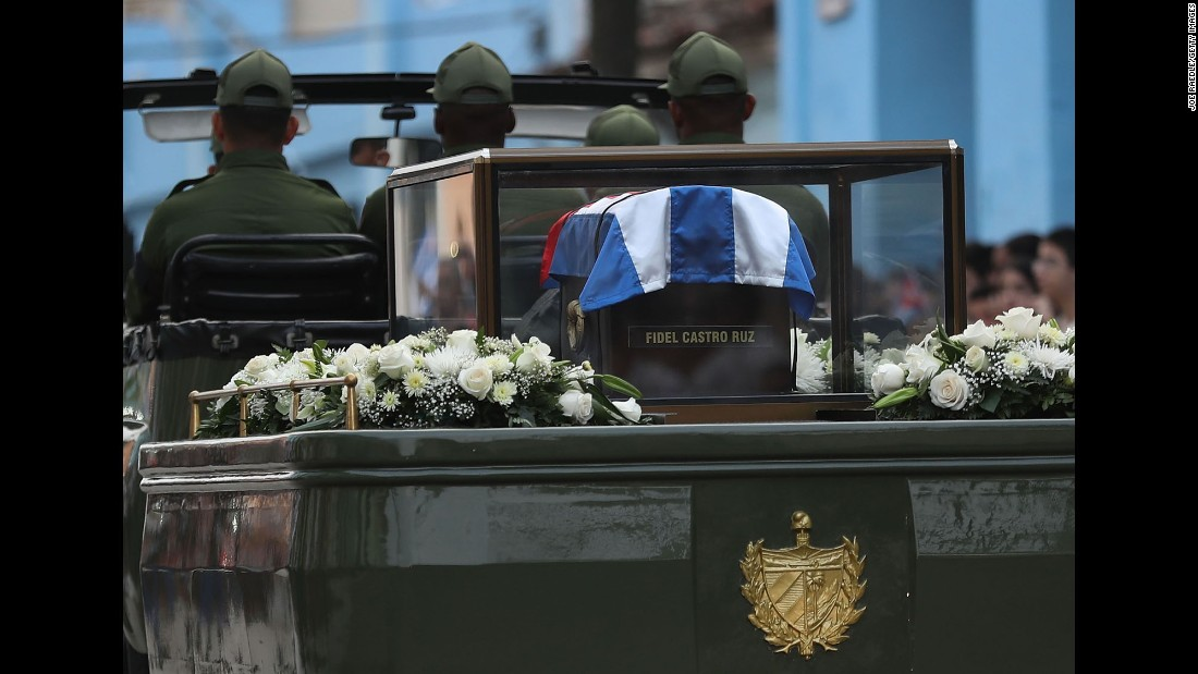 The trailer of a military jeep carries the flag-draped coffin containing Castro's ashes.
