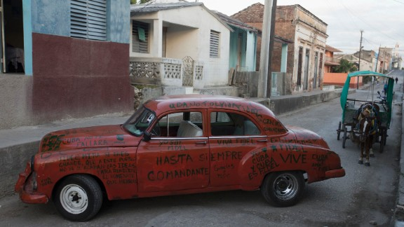 A car adorned with messages to Castro sits parked on a street in La Esperanza, Cuba, on Wednesday, November 30.