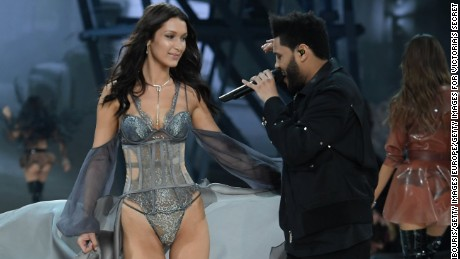 PARIS, FRANCE - NOVEMBER 30:  Bella Hadid walks the runway while The Weeknd performs during the 2016 Victoria's Secret Fashion Show on November 30, 2016 in Paris, France.  (Photo by Dimitrios Kambouris/Getty Images for Victoria's Secret)