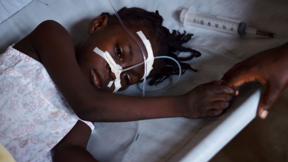 A young girl, with cholera symptoms is treated at the Cholera Treatment Center of Diquini in Port-au-Prince, Haiti on 23 August, 2016.  The cholera epidemic that started in 2010 has infected some 800,000 and killed nearly 10,000 people.  / AFP / HECTOR RETAMAL        (Photo credit should read HECTOR RETAMAL/AFP/Getty Images)