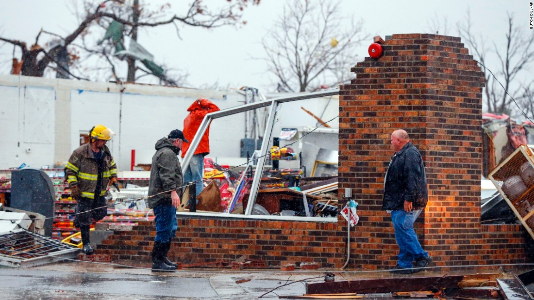 A firefighter helps remove debris from the Rosalie Plaza after a tornado ripped through Rosalie, Alabama, on Wednesday, November 30.