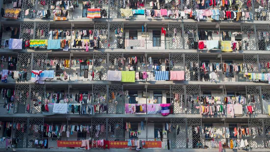 Students at the Hubei University of Chinese Medicine take advantage of a sunny day to dry laundry and bedding on their dormitory balconies on Saturday, November 26.