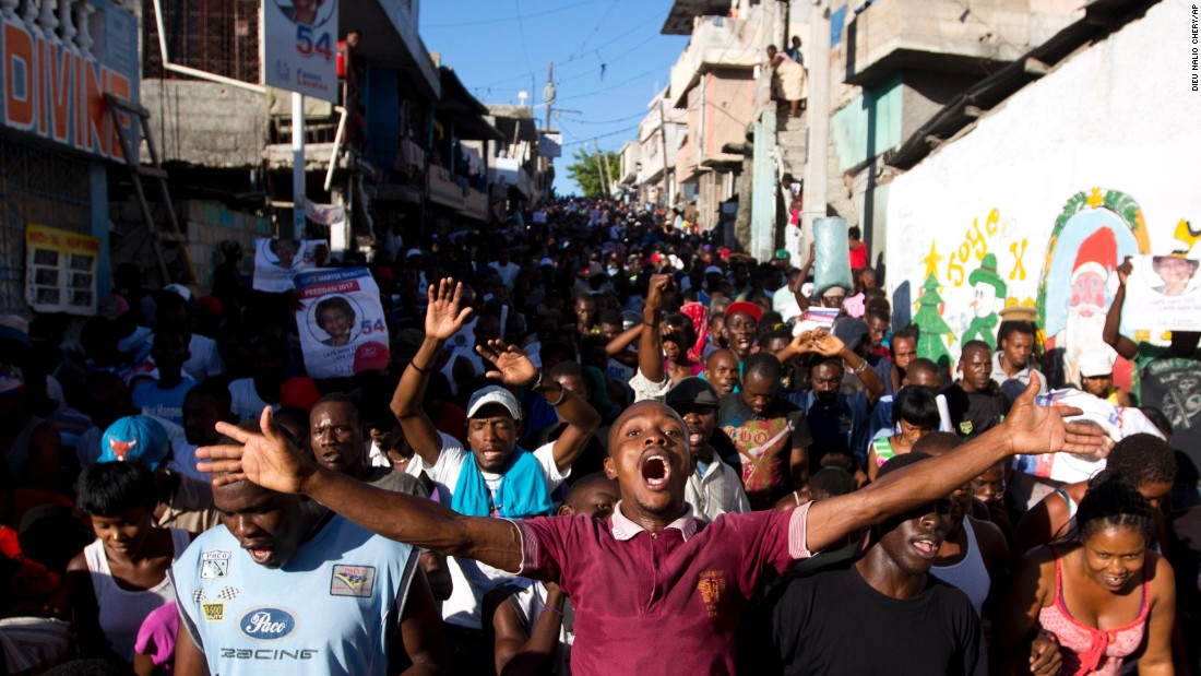 Supporters of Haitian presidential candidate Maryse Narcisse march in Port-au-Prince, Haiti, on Monday, November 28.