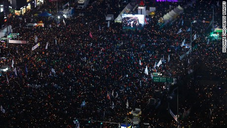 Hundreds of thousands took to the streets of Seoul to protest Park.