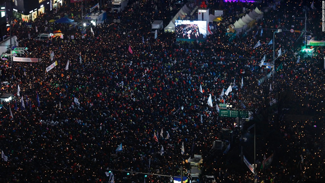 "Demonstrators hold candles during an anti-government protest in Seoul, South Korea, on Saturday, November 26. Hundreds of thousands of people <a href=""http://www.cnn.com/2016/11/26/asia/south-korea-mass-protests/"" target=""_blank"">took to the streets</a> to call for President Park Geun-hye's resignation. Park's opposition has grown following her unprecedented admission that she shared classified information with someone who lacked the necessary security clearance."