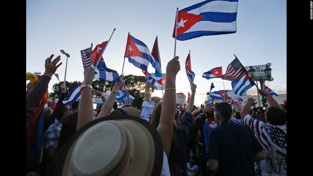"Members of the Cuban community in Miami react to <a href=""http://www.cnn.com/2016/11/26/americas/fidel-castro-obit/"" target=""_blank"">the death of Fidel Castro</a> on Saturday, November 26."