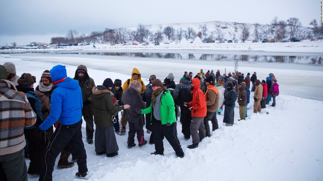 A procession makes its way down to the Cannonball River to take part in a Native American water ceremony on December 1.