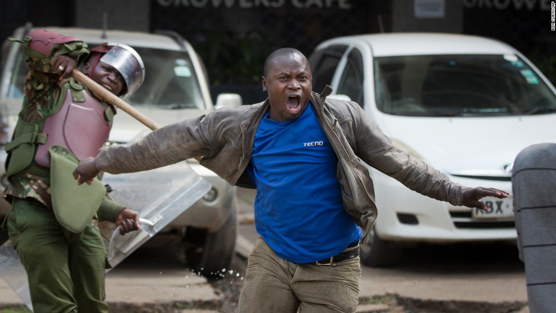 "<strong>May 16:</strong> An opposition protester yells as he is beaten by riot police in Nairobi, Kenya. Police in Kenya's capital <a href=""http://www.cnn.com/2016/05/17/africa/kenya-police-violence/"" target=""_blank"">came under fire</a> for what critics said was a heavy-handed response to a largely peaceful opposition protest. Kenya's police chief called for an internal investigation, according to Interior Ministry spokesman Mwenda Njoka."