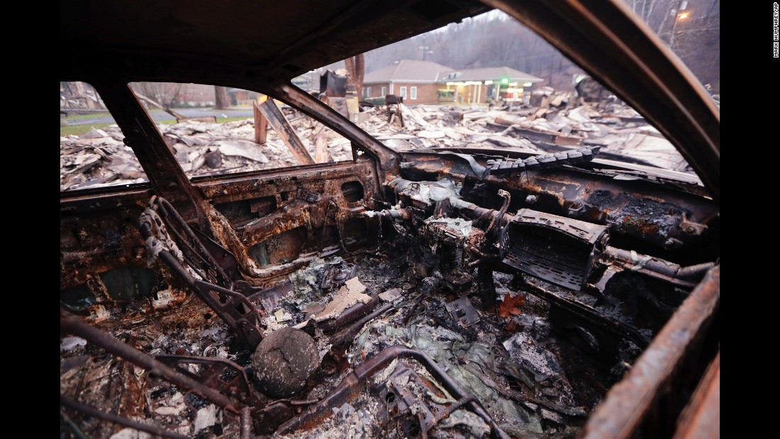 "<strong>November 30:</strong> A burned car sits in a parking lot after a wildfire swept through Gatlinburg, Tennessee. Gatlinburg city officials declared mandatory evacuations in several areas as firefighters <a href=""http://www.cnn.com/2016/11/28/us/southern-fires-gatlinburg-smokies/index.html"" target=""_blank"">battled at least 14 fires in and around the city.</a>"