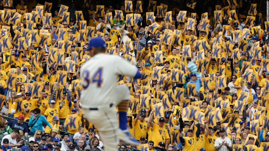 "Fans of the Seattle Mariners hold up signs for pitcher Felix Hernandez as he winds up for a pitch on Sunday, April 10. The ""K"" stands for strikeout in baseball terminology."