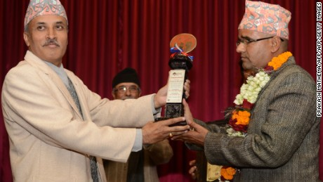 Nepalese civil servant Gyan Mani Nepal receives the inaugural Integrity Idol trophy for 2014.