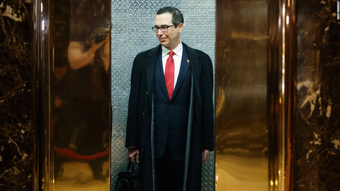 "Steven Mnuchin, President-elect Donald Trump's <a href=""http://money.cnn.com/2016/11/29/news/economy/donald-trump-steven-mnuchin-treasury/"" target=""_blank"">nominee for Treasury Secretary</a>, waits in an elevator at Trump Tower after speaking with reporters on Wednesday, November 30."