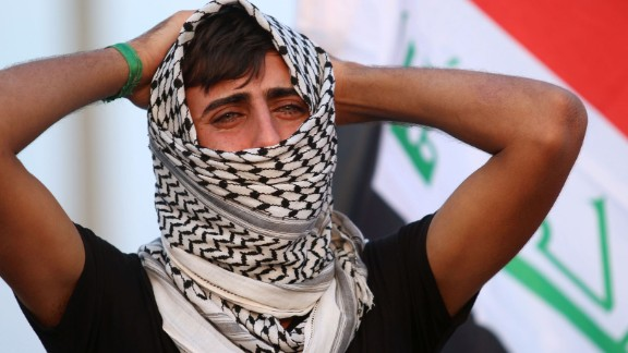 A man mourns during the funeral of four Iraqi paramilitary fighters who were killed in battles in the town of Tal Afar.