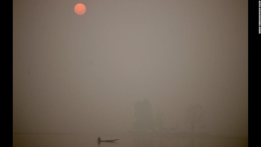 A fisherman rows across Dal Lake at sunset in Srinagar, India, on November 23 as subzero temperatures grip the area.