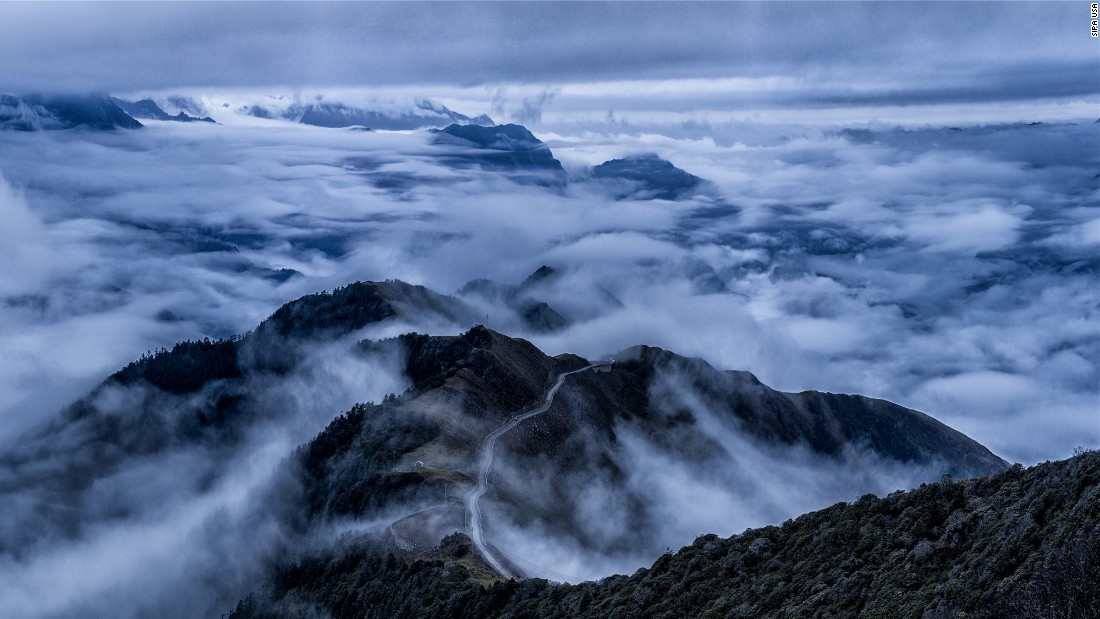 Clouds drift over Mount Dawagengzha in China's Sichuan province on November 7.