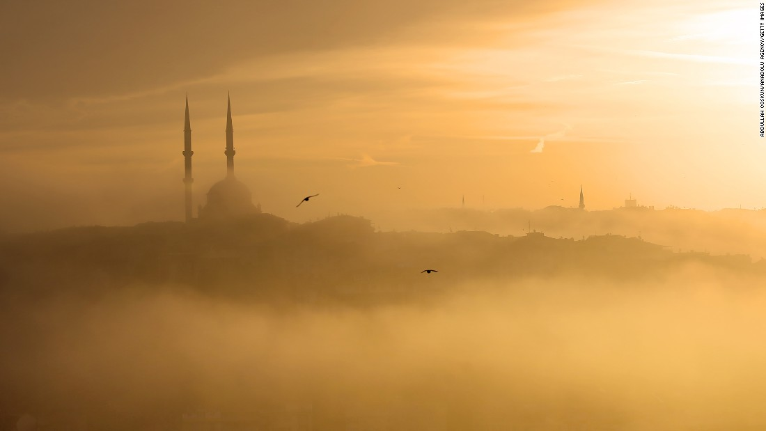 Morning fog covers the Golden Horn, as seen from the Pierre Loti cafe in Istanbul's Eyup District, on November 12.