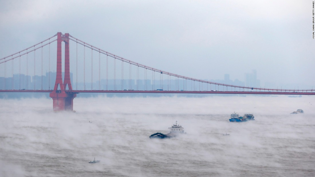 Ships sail on the foggy Yangtze River in Wuhan, China, on November 23.
