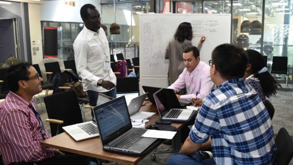 """Siwo believes cancer and other non-communicable diseases will start to impact Africans more so than elsewhere, due to how unprepared the region is to handle new cases. """"We are attempting to find long term solutions,"""" he says.  Pictured: researchers at work in South Africa."""