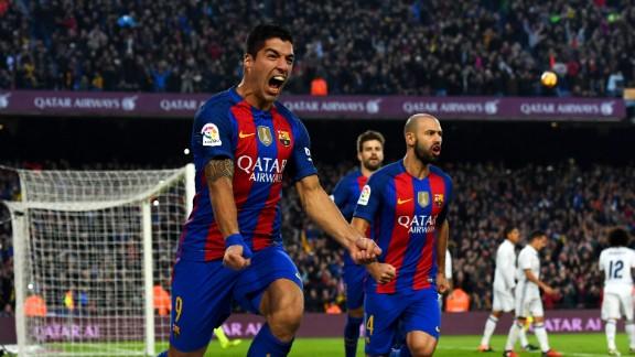 Luis Suarez celebrates scoring the opening goal in El Clasico for Barcelona.