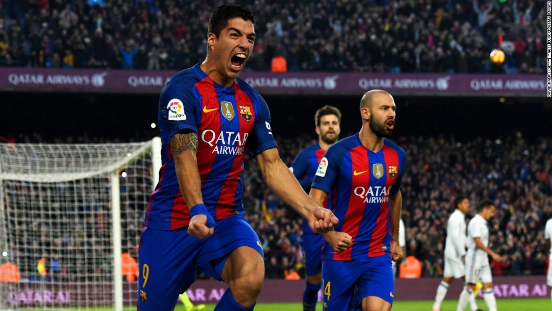 Luis Suarez celebrates scoring the opening goal in El Clasico for Barcelona.