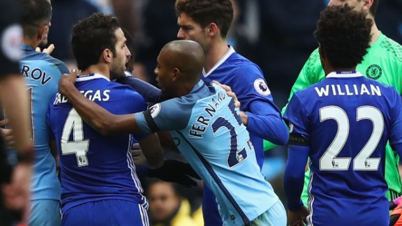 Fernandinho grabs Cesc Fabregas in the clashes in stoppage time. The Manchester City player was red carded in the incident.