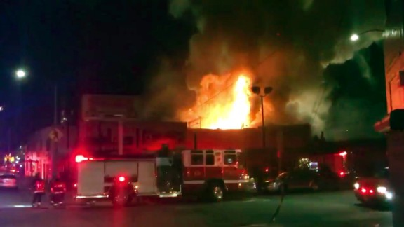 This photo taken from video provided by @Oaklandfirelive shows the scene of a fire in Oakland, early Saturday, December 3, 2016.  The blaze began at about 11:30 p.m. on Friday during a party at a warehouse in the San Francisco Bay Area city.  Several people were unaccounted for. Oakland Fire Department posted several messages throughout the night on its Twitter social media network account, including the latest one in the morning saying that fire crews would remain on the scene for several more hours to extinguish hot spots