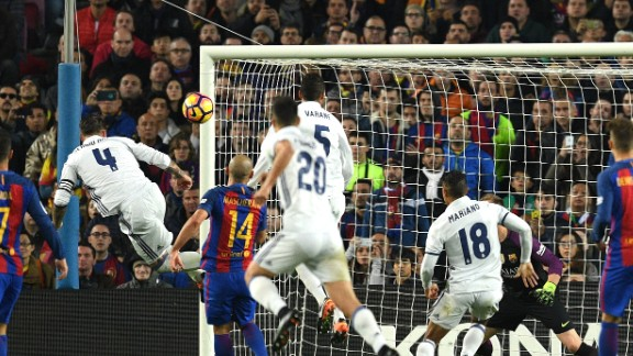 Ramos (No.4) heads the late equalizer for Los Blancos in El Clasico.