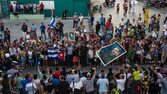 Cubans see the ashes of Fidel Castro being carried by a special convoy through the city of Holguin on Saturday, December 3.