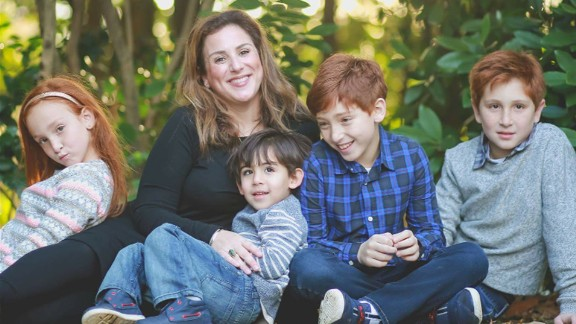 Monica Schulman, 38, with her four children. She is among the 15% of Parkinson's disease patients under the age of 40.