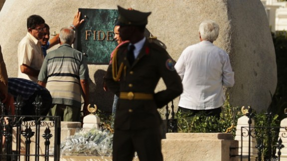 """Workers place a plaque with the word """"Fidel"""" on the tomb holding the remains of former Cuban President Fidel Castro in the Cementerio Santa Ifigenia where he was buried, Sunday, December 4, in Santiago de Cuba. Cubans are honoring his life this week."""