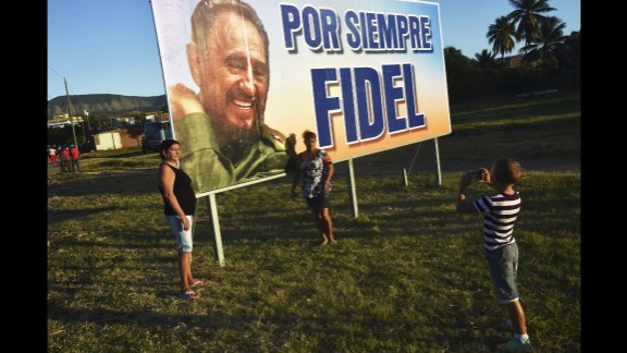 Cubans await for the passage of the urn containing the ashes of Fidel Castro on December 4.