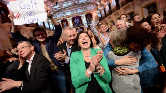 """Alexander Van der Bellen supporters hold a sign readig """"Thank God"""" as exit polls come in on Sunday."""