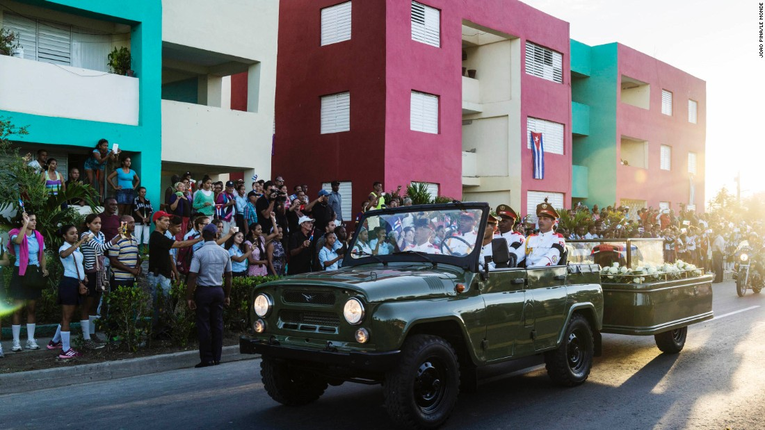 Fidel Castro's ashes pass on the streets going to the cemetery in Santiago de Cuba on December 4.