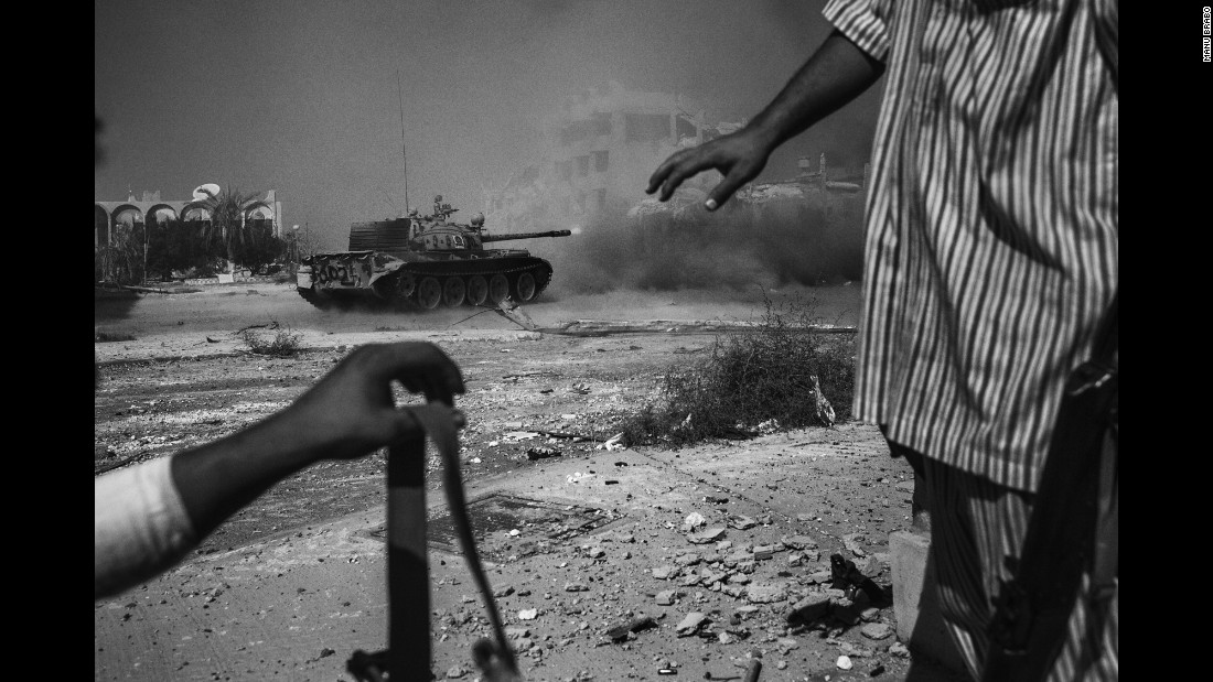 A tank fires against ISIS positions in Sirte, Libya, in September. Photographer Manu Brabo documented the monthslong battle that ended with Sirte's liberation in early December.