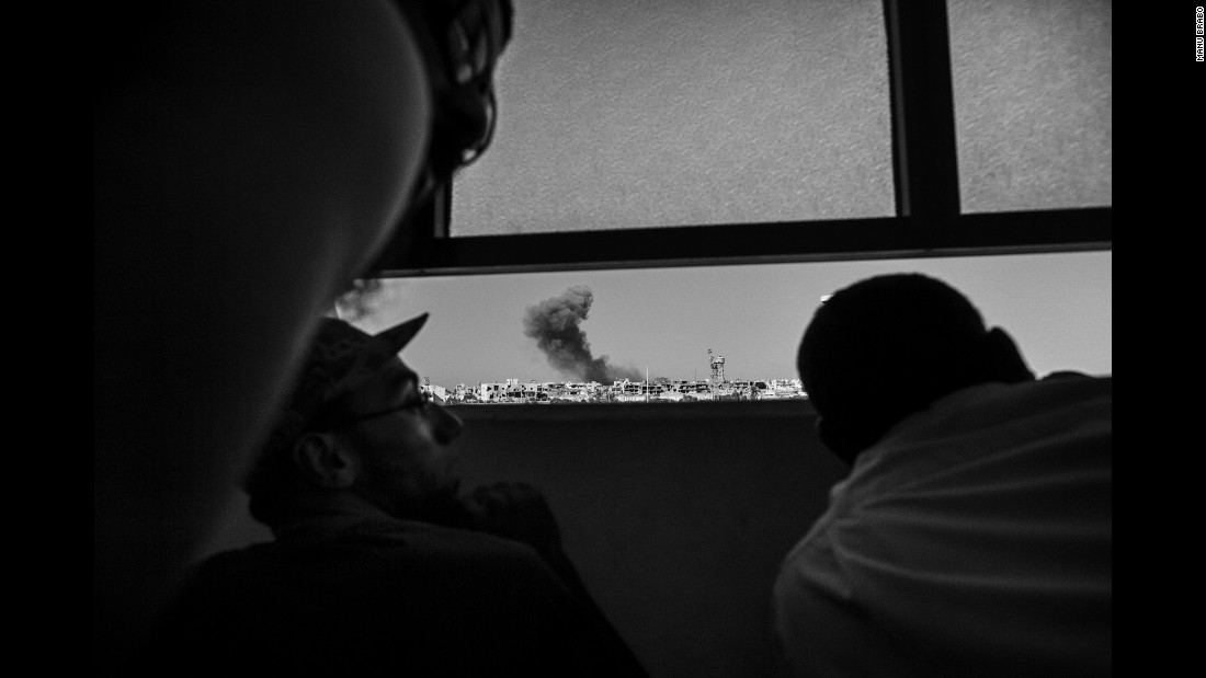 Libyan forces watch an airstrike on ISIS positions in September.