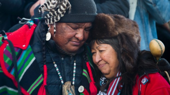 Activists embrace after the December halt of the Dakota Access Pipeline route. The $3.7 billion project that would cross four states and change the landscape of the US crude oil supply. The Standing Rock Sioux tribe says the pipeline would affect its drinking-water supply and destroy its sacred sites.