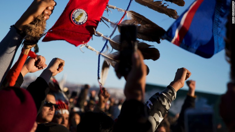 A crowd celebrates at the Oceti Sakowin camp after it was announced that the U.S. Army Corps of Engineers won't grant easement for the Dakota Access oil pipeline in Cannon Ball, N.D., Sunday, Dec. 4, 2016. (AP Photo/David Goldman)