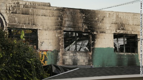 OAKLAND, CA - DECEMBER 04: The burnt exterior of a warehouse in which a fire claimed the lives of at least thirty-three people is seen on December 4, 2016 in Oakland, California. The fire took place during a musical event late Friday night. (Photo by Elijah Nouvelage/Getty Images)