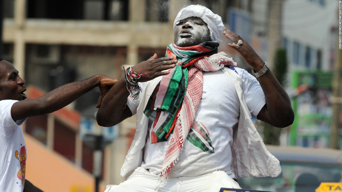 A Supporter of National Democratic Congress (NDC) celebrates sitting on a taxi shortly after John Atta Mills is declared winner of the run off presidential election in Accra Saturday, on January 3, 2009.