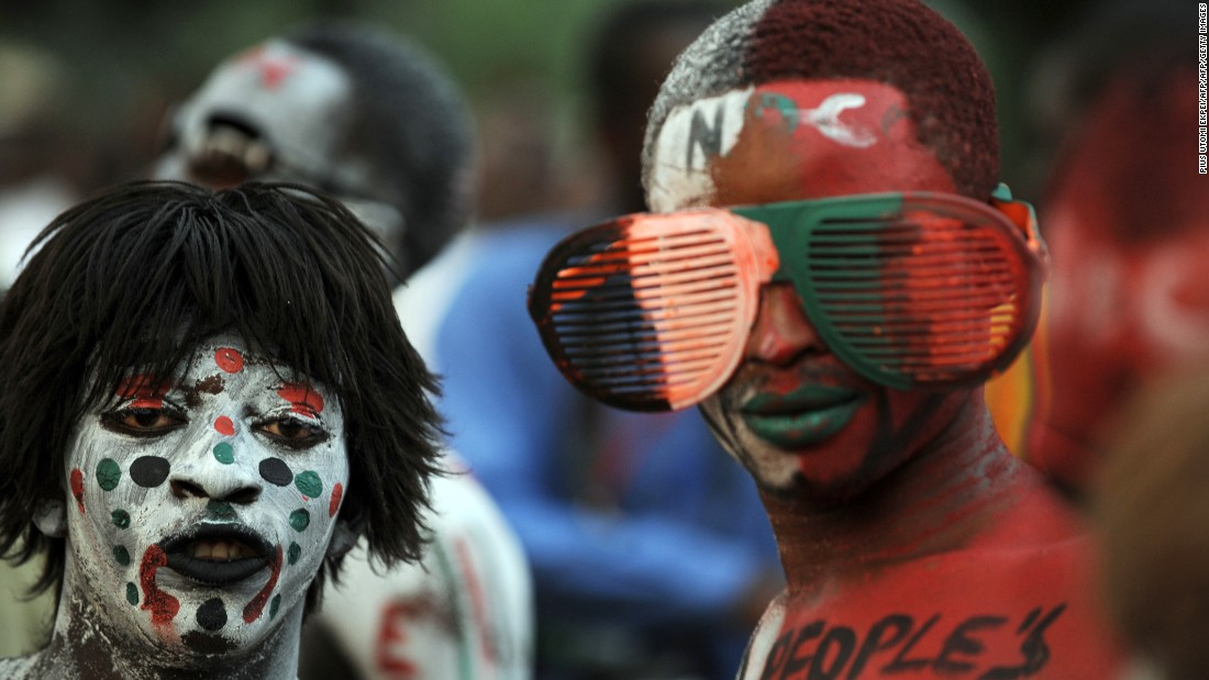 National Democratic Congress party supporters with their bodies painted in party colors at a rally to cheer re-elected Ghanaian President John Dramani Mahama as he accepts his mandate on December 10, 2012
