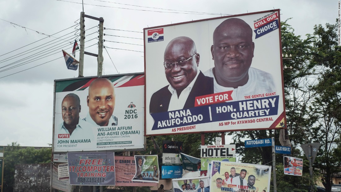A picture taken in the streets of Accra showing campaign billboards of Ghana's two main political parties running in this years national election.