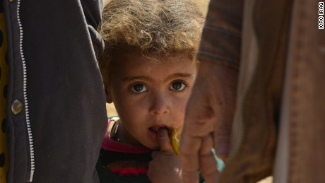 Children are reportedly dying of cold in the desert north of Mosul.
