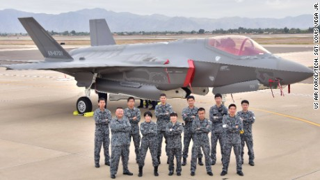 Japanese Air Self-Defense Force personnel pose for a photo during the arrival of the first Japanese F-35A at Luke Air Force Base, Arizona, in 2016.