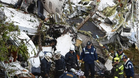 EDITORS NOTE: Graphic content / Rescue teams work in the recovery of the bodies of victims of the LAMIA airlines charter that crashed in the mountains of Cerro Gordo, municipality of La Union, Colombia, on November 29, 2016 carrying members of the Brazilian football team Chapecoense Real. A charter plane carrying the Brazilian football team crashed in the mountains in Colombia late Monday, killing as many as 75 people, officials said. / AFP / STR / Raul ARBOLEDA / GRAPHIC CONTENT        (Photo credit should read RAUL ARBOLEDA/AFP/Getty Images)