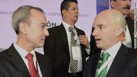 Pemex oil company president Jose Antonio Gonzalez (R) talks to Timothy Joseph Callahan (L), a representative of BHP Billiton Petroleo Operaciones de Mexico, at the Centro Banamex, where BHP won the auction for the Trion oilfield with an investment of 624 million dollars, in Mexico City on December 5, 2016.  / AFP / ALFREDO ESTRELLA        (Photo credit should read ALFREDO ESTRELLA/AFP/Getty Images)