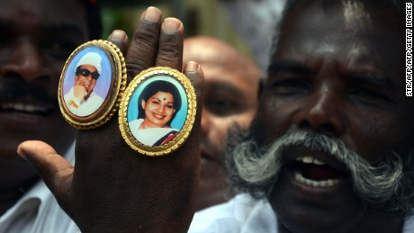Jayalalithaa (R) and M. G. Ramachandran (L) pictured on the hand of a party supporter.
